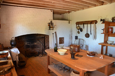 The kitchen, located under the east branch of the house.