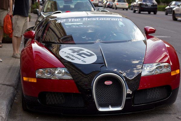 Front view: A $1+ million Bugatti Veyron supercar parked in the street in Montreal.