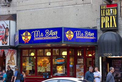 Street scene: A burger joint called Mr. Steer in between two strip clubs in Montreal.