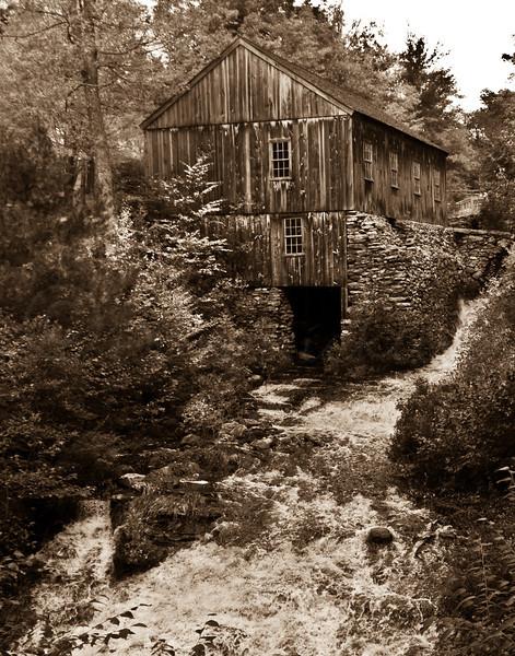 Monotone Sawmill with river in spate.