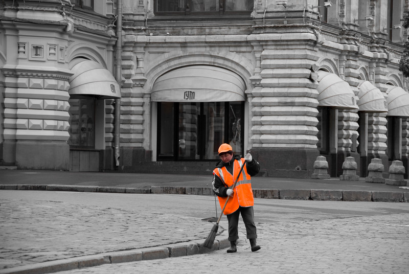 Woman cleaning Red Square at the morning