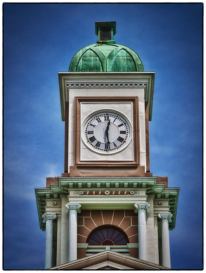 The clock on top of the Knox County Court House on East High Street in Mount Vernon, Ohio. It was built in 1855 in the Greek Revival style of architecture. The architects were Daniel Clark and John Jennings. The courthouse was listed on the National Register of Historic Places on June 4, 1973. Photo was shot on morning of June 9, 2012.