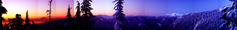 Sunset Panorama A stitched panorama taken from near Mystery Peak on Mt. Seymour. The unprocessed image had a natural red-blue gradient in it, which I enhanced in Gimp by merging it with an artificial gradient.   The stitching software that came with my new camera doesn't automatically fix the colors in the overlap regions, unfortunately. I'd like to redo this one with better software to get rid of those discontinuities in the sky.