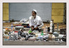 This person was selling a whole lot of stuff, valves, vanity bag, clocks, table lamps, figurines and other stuff! <br /> Chor Bazar