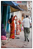 Ladies covering faces as Sharookh walks by<br /> Kamathipura, Mumbai<br /> <br /> Shot blind with camera at waist level.