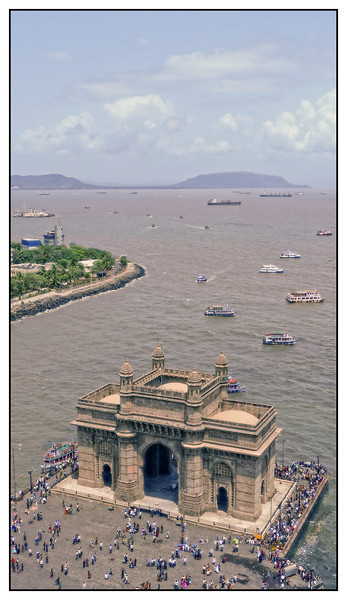 "<span style=""color:yellow"">Gateway of India</span>  from Taj Mahal Hotel Leica D-Lux 5<br> The Gateway of India was built to commemorate the visit of King George V and Queen Mary to Bombay in December 1911. Its design is a combination of both Hindu and Muslim architectural styles, the arch is in Muslim style while the decorations are in Hindu style. The Gateway is built from yellow basalt and reinforced concrete. The Gateway was opened on 4 December 1924, by the Viceroy, the Earl of Reading. The last British troops to leave India, the First Battalion of the Somerset Light Infantry, passed through the Gateway in a ceremony on 28 February 1948 <br> http://en.wikipedia.org/wiki/Gateway_of_India"