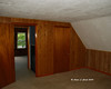 Day #2<br /> The master bedroom before taking the paneling down
