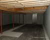 In the basement.  The concrete rectangle on the ground will be the base of the chimney