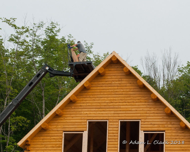 The builders working on the roof