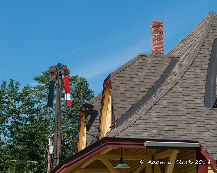 Dormers on the roof and the old semaphore out front