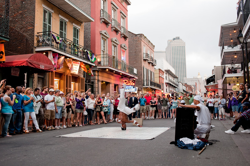 A breakdancer doing a headspin in the French Quarter, NOLA