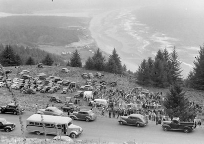 In the early 1950s, Neahkahnie Meadows become a nine-hole golf course. This image captures a community picnic held before course development began.
