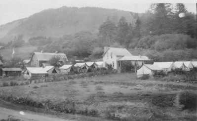 "Early visitors stayed in tents rented from nearby residents. The ""campground"" above was on Nehalem Road about a quarter mile from the beach."