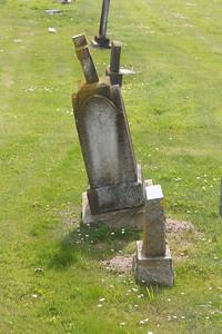 Gravestone keeling over