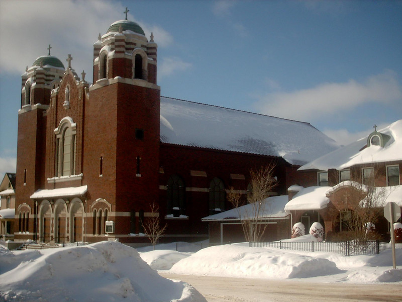 <b>St. Paul Catholic Church (winter)</b> - The same as the previous shot only the middle of winter. As of the date this photo was taken we'd had about 183 inches of snow so far for the season with a snowdepth right around 40 inches or so. Fairly average for that time of year. 3-2-05
