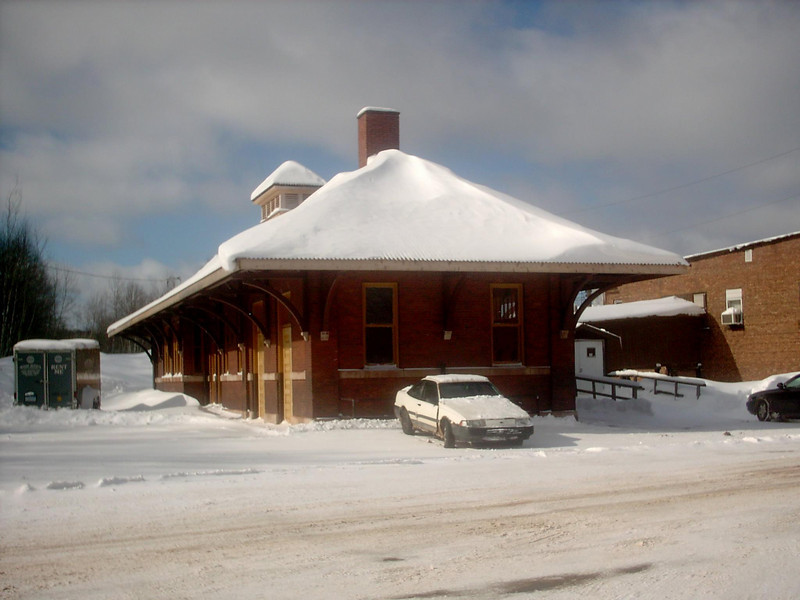 <b>Train Depot (Winter)</b> - The same as the previous shot only the middle of winter. As of the date this photo was taken we'd had about 183 inches of snow so far for the season with a snowdepth right around 40 inches or so. Fairly average for that time of year. 3-2-05