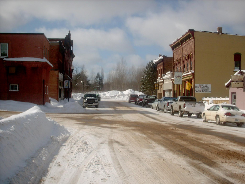 <b>West Iron Street (winter)</b> - The same as the previous shot only the middle of winter. As of the date this photo was taken we'd had about 183 inches of snow so far for the season with a snowdepth right around 40 inches or so. Fairly average for that time of year. 3-2-05