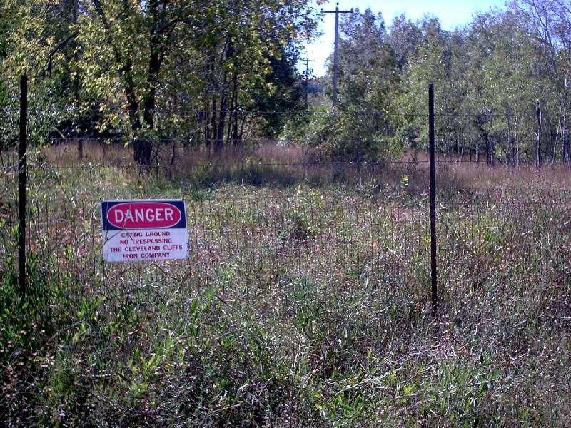 <b>Caving Grounds</b> - Many open areas around town are fenced off from the public for safety. These areas are undercut by old mine shafts which could be covered by thin layers of topsoil.