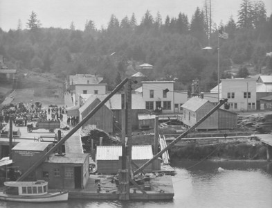 Corner of Tohl Avenue and Main Street in 1914. The barge with cranes in the foreground was used to build the jetties.