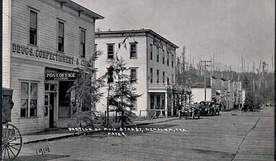 Main street in 1914. The plank road built on pilings allowed tides in the bay to rise without flooding the street.