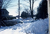 Winter scenery, 430 Main Street, Acton, Massachusetts, 1950's. Ray and Edie Hatch's place across the street, with the apple orchard behind and Taylor Road running down the far side of it.