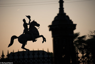 Early morning in the French Quarter - Saint Peter Street adjacent to Jackson Square. Saint Louis Cathedral in the background. Silhouette of General Andrew Jackson. Jackson is the famous hero of the Battle of New Orleans during the War of 1812 who overwhelming defeated a superior British force.