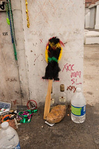 """Tomb of Maries Layeau, """"Voodo Queen"""", 1794-1881.  Louisiana Creole practitioner of Voodoo was renowned in New Orleans. Visitors draw three """"x""""s (XXX) on the side, in the hopes that Laveau's spirit will grant them a wish."""