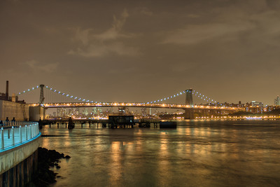 Williamsburg Bridge across East River, NY.  Taken with Nikon D90 and Nikkor 24-70-mm  lens. Processed with Photomatix Pro 4.1 and Photoshop CS5.