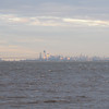 Taken from the Belford New Jersey Ferry terminal looking almost straight north at the Verrazano Narrows Bridge and Manhattan in the distance.