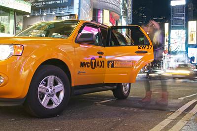Catching a cab in Times Square ref: e907e88b-2333-47e1-9d4e-a161cbb1c29f