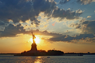 Setting Sun behind the Statue of Liberty-