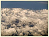"""4th year Pic 198 - Aug - 11 2012. <span style=""""color:yellow""""> Through the clouds </span> - To Hong Kong Saw this beautiful sight as we were leaving New Zealand.  L Perry has pointed out that this may be Ruapehu peak. - Thanks!"""