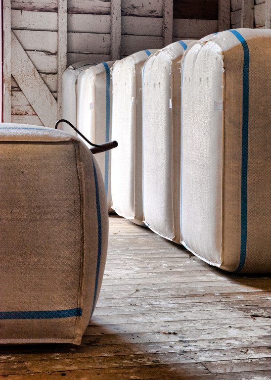 Wool bales ready for shipping from heritage shearing shed, North Island, New Zealand