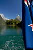Mitre Peak with New Zealand flag - Milford Sound, New Zealand