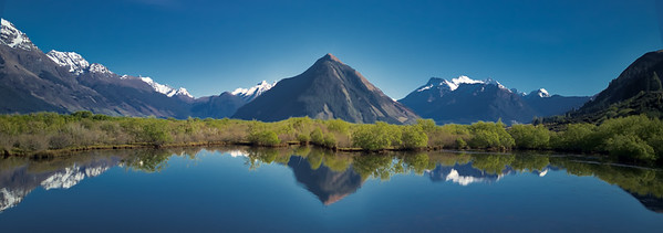 Reflections in the lake near Glenorchy. Mount Alfred is in the distance, showing off.