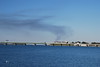 The Claiborne Pell Bridge (Newport Bridge) with Rocky Point burning in background (smoke).