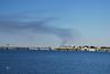 The Claiborne Pell Bridge (Newport Bridge) with Rocky Point burning in background (smoke).