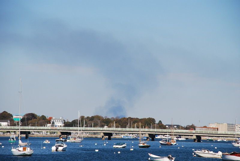 Claiborne Pell Bridge (Newport Bridge) with Rocky Point burning in background (smoke).