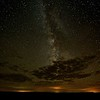 Vast clouds of dust eclipse the center of the Milky Way.  These clouds are eclipsed by earth's clouds.