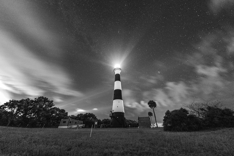 Black and white -- The Cape Canaveral Lighthouse on the early morning hours of August 11th, 2018 as clouds roll through the sky before the first launch attempt of the Parker Solar Probe.