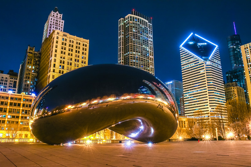 The Bean (cloud gate) in Millenium Park downtown Chicago at midnight.