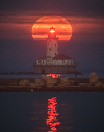 Supermoon rising behind the Chicago Harbor Lighthouse on December 3rd, 2017.