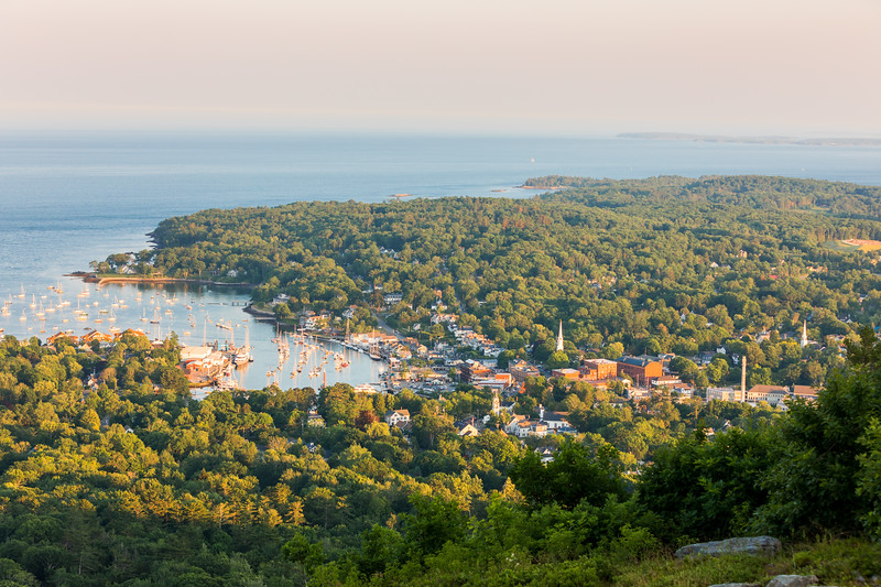 Camden, Maine and the surrounding landscape from the summit of Mount Battie in Camden Hills State Park.
