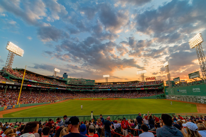 The sun sets over Fenway Park from section 42.