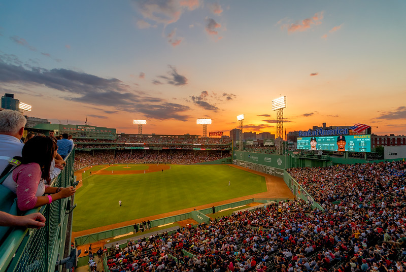 The sun sets over Fenway Park.