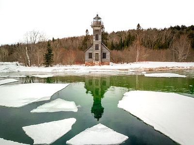 Ice moving across the East Channel in front of the Grand Island Lighthouse in Munising, Michigan.