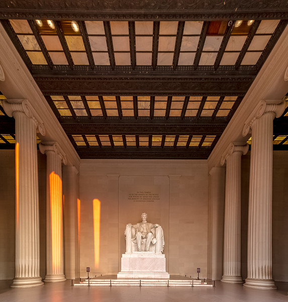 Sunlight shines through the columns at the Lincoln Memorial just after sunrise.