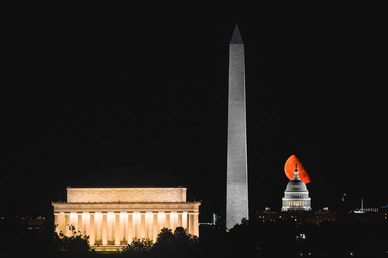 Last quarter Moon rising behind the U.S. Capitol in Washington D.C.