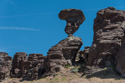 Estimated weight of Balanced rock is  40 tons and is balanced on a pedestal, 17  by 36 inches.  Balanced rock park, Idaho.