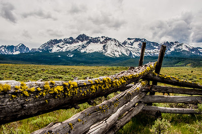Cattle fence with Sawtooth mountains in background.  Stanly, Idaho.